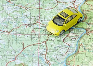 11272501-car-travel-choose-route-on-the-map-stock-photo