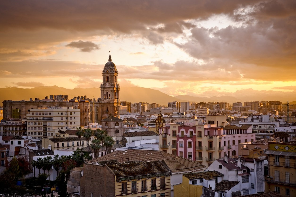 View of the city of Malaga, capital of the Costa del Sol (southern Spain), at the sunset.