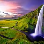 Waterfall against sunset in Iceland