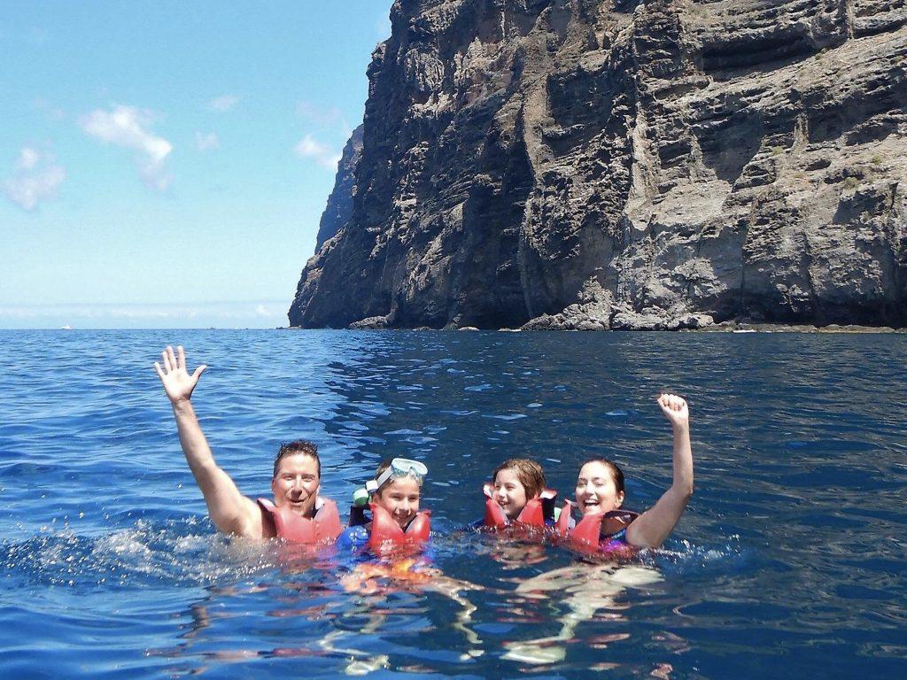 Family swimming in ocean in Tenerife