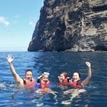 Family swimming in ocean in Tenerife